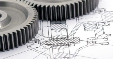 Graue Zahnräde auf einem Entwurf einer Maschine